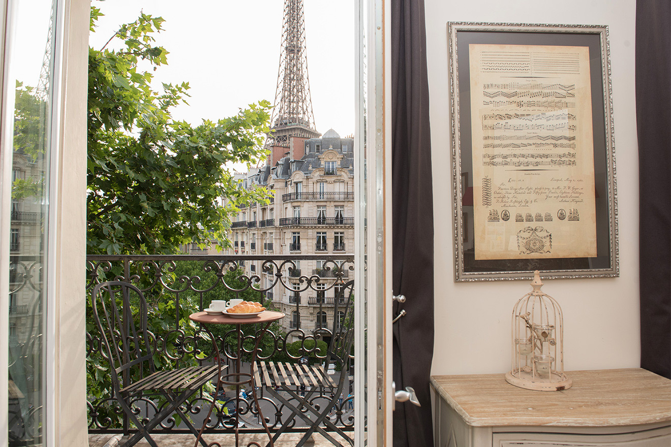 Amazing Eiffel Tower view from the living room of the Champagne vacation rental offered by Paris Perfect