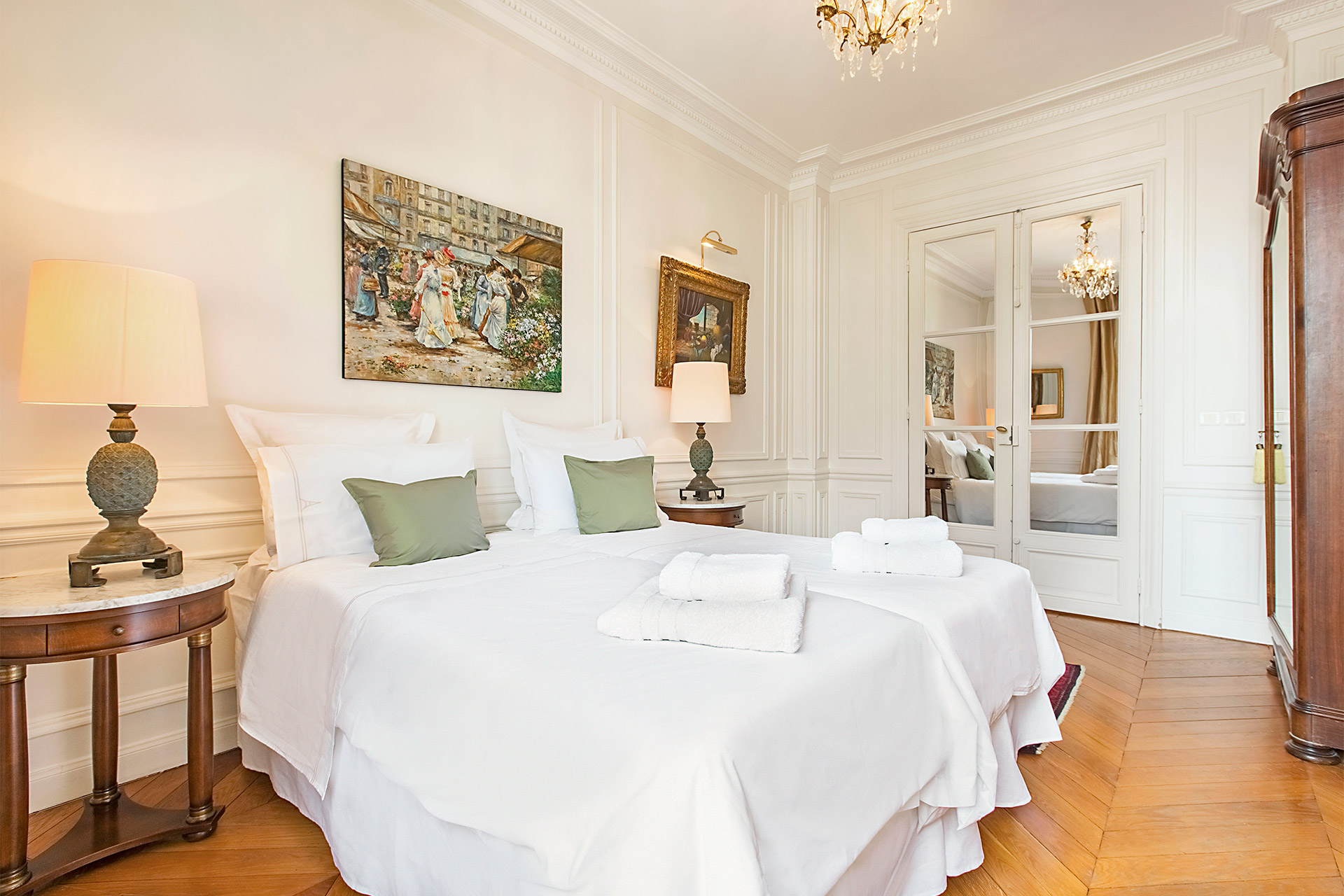 Comfortable twin beds in the second bedroom of the Chateauneuf vacation rental offered by Paris Perfect