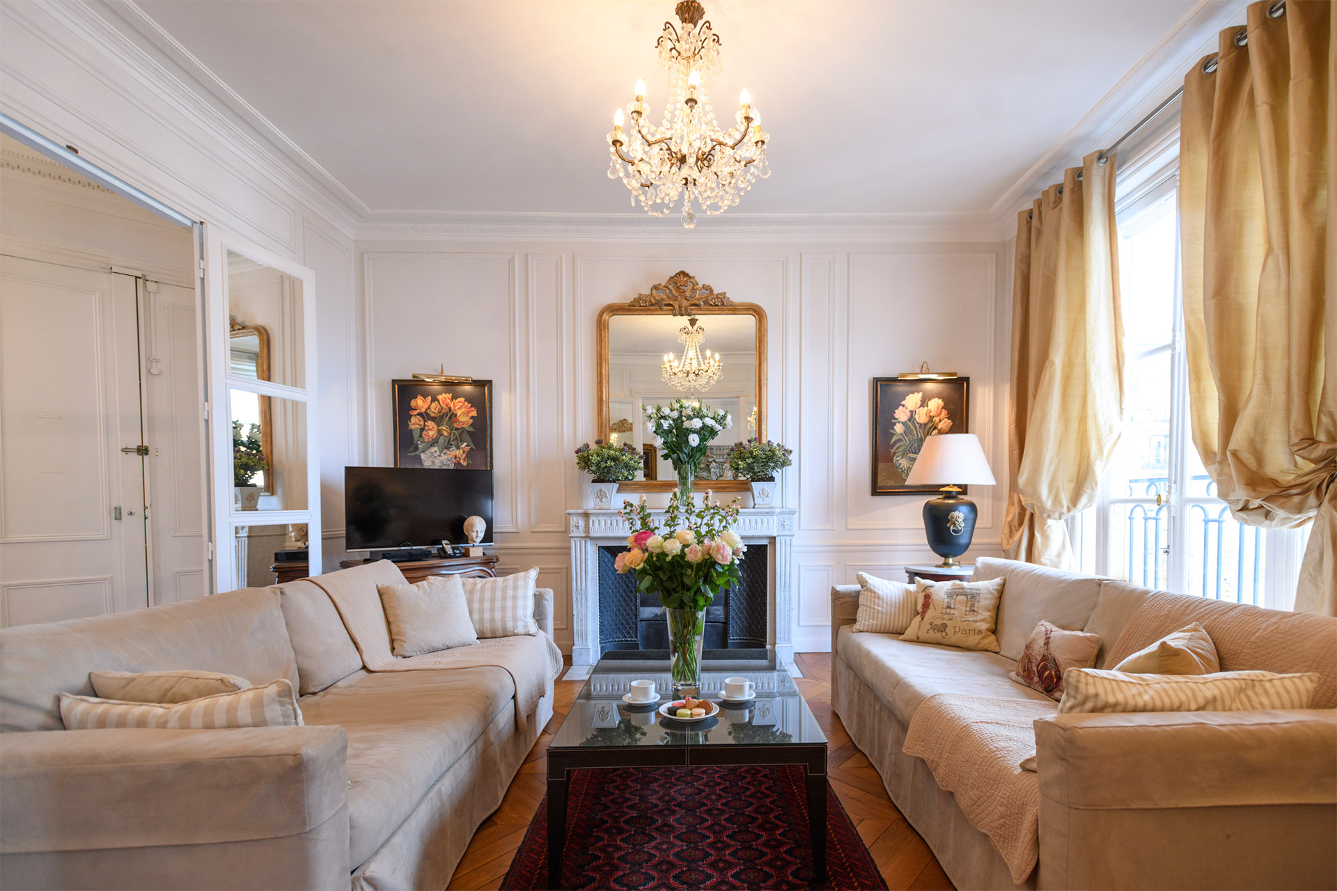 Gorgeous and spacious living room of the Chateauneuf vacation rental offered by Paris Perfect