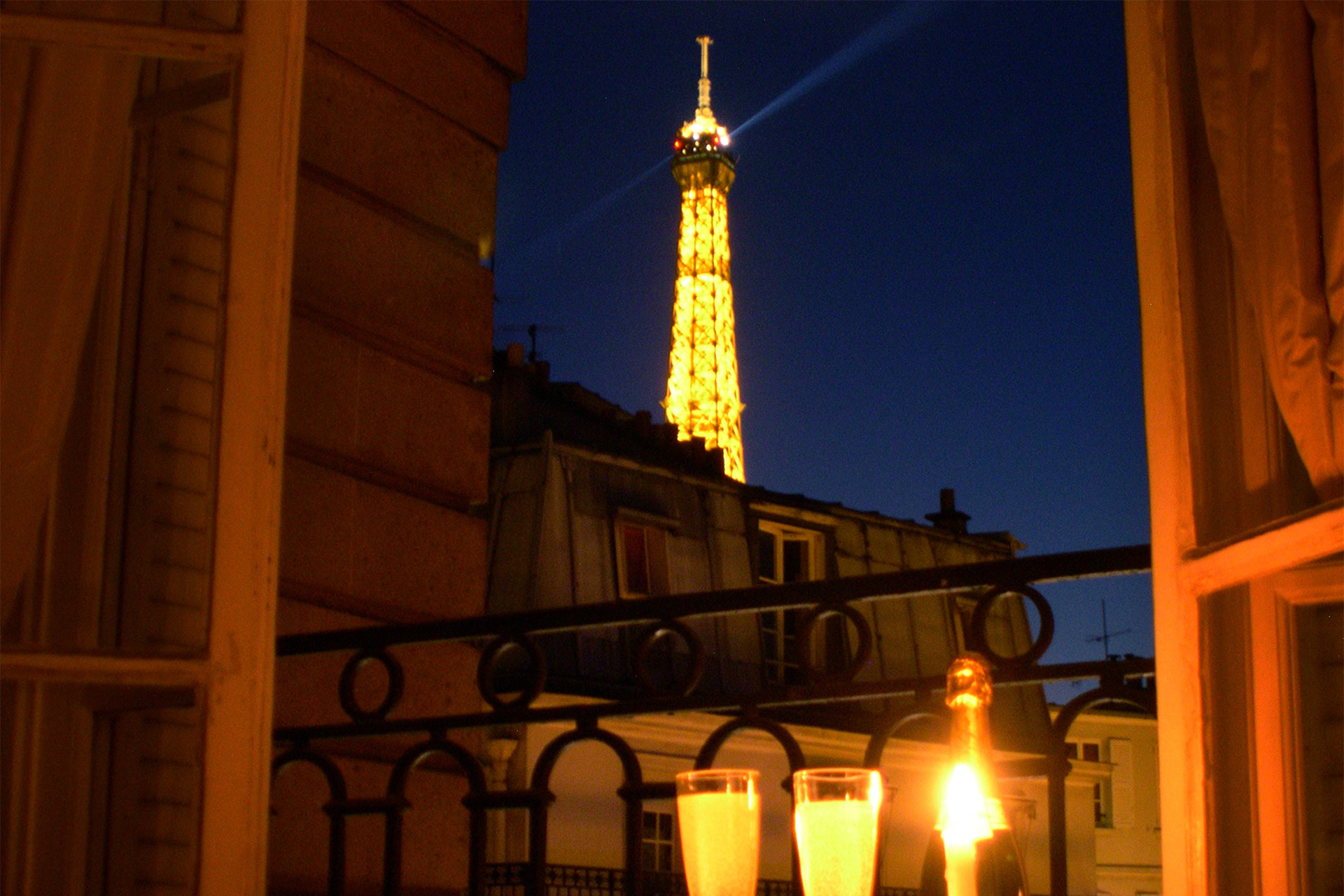 Watch the lights sparkle on the Eiffel Tower at the Chateauneuf vacation rental offered by Paris Perfect