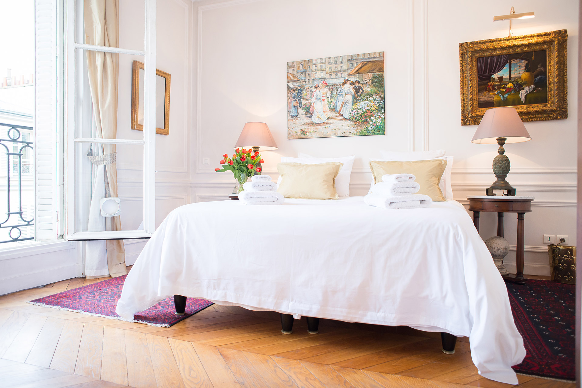 Large windows in this bedroom of the Chateauneuf vacation rental offered by Paris Perfect