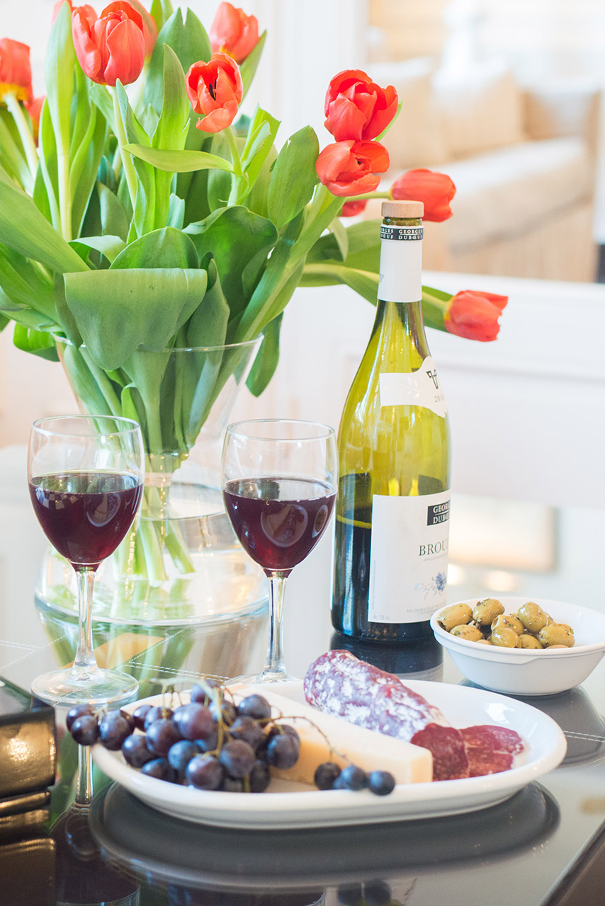 Toast your stay with a French wine at the Chateauneuf vacation rental offered by Paris Perfect