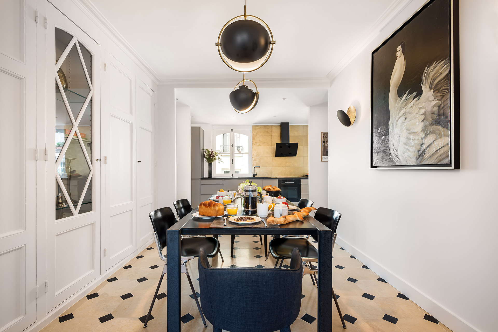 Parquet floors and high ceiling in the Chevalier vacation rental offered by Paris Perfect