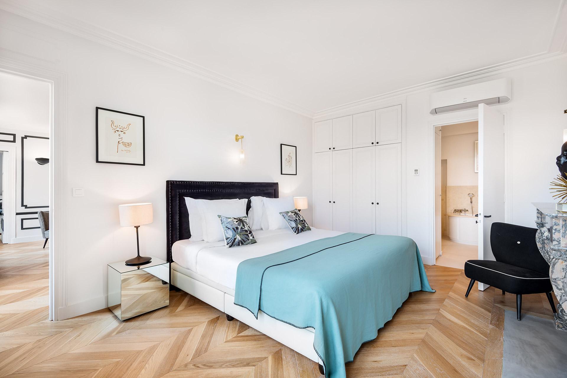 Bedroom 1 with en suite bathroom in the Chevalier vacation rental by Paris Perfect