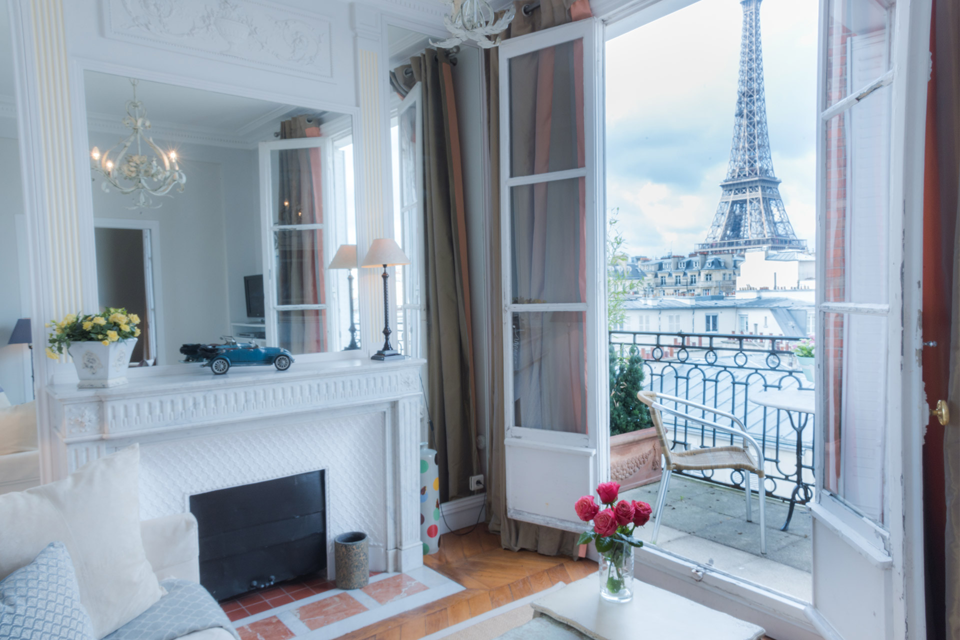 Living Room Den with a stunning Eiffel Tower view at the Cognac vacation rental offered by Paris Perfect