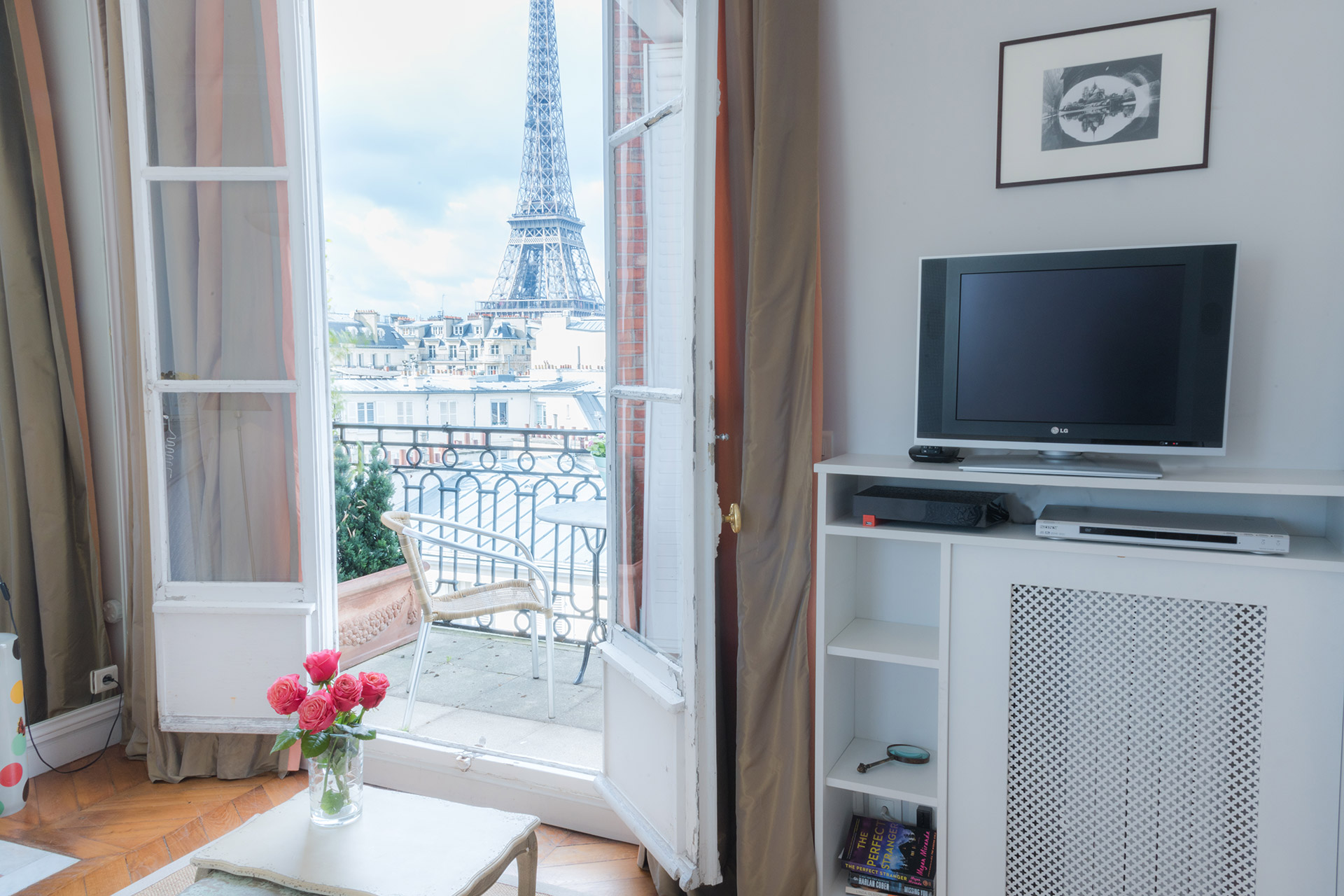 Watch TV or the Eiffel Tower in the Cognac vacation rental offered by Paris Perfect