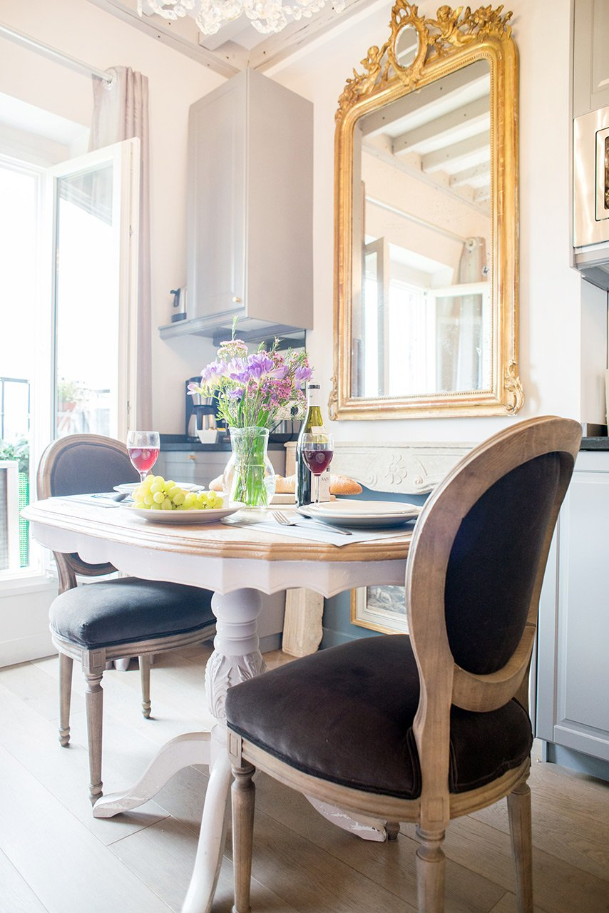 Antique touches throughout the apartment give it a Parisian feeling in the Cremant vacation rental