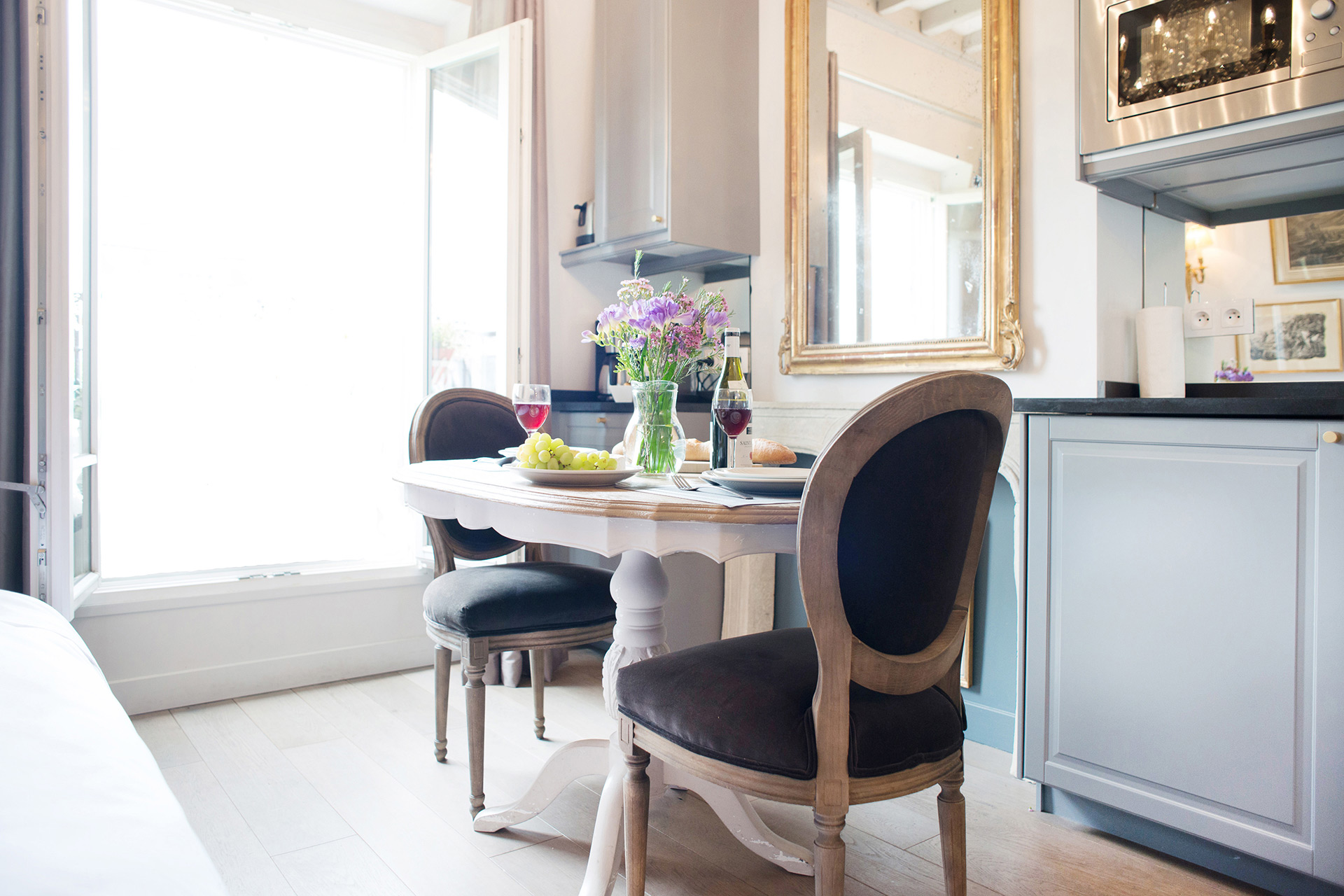 The dining area easily flows into the kitchen for easy meals in the Cremant Paris Perfect rental