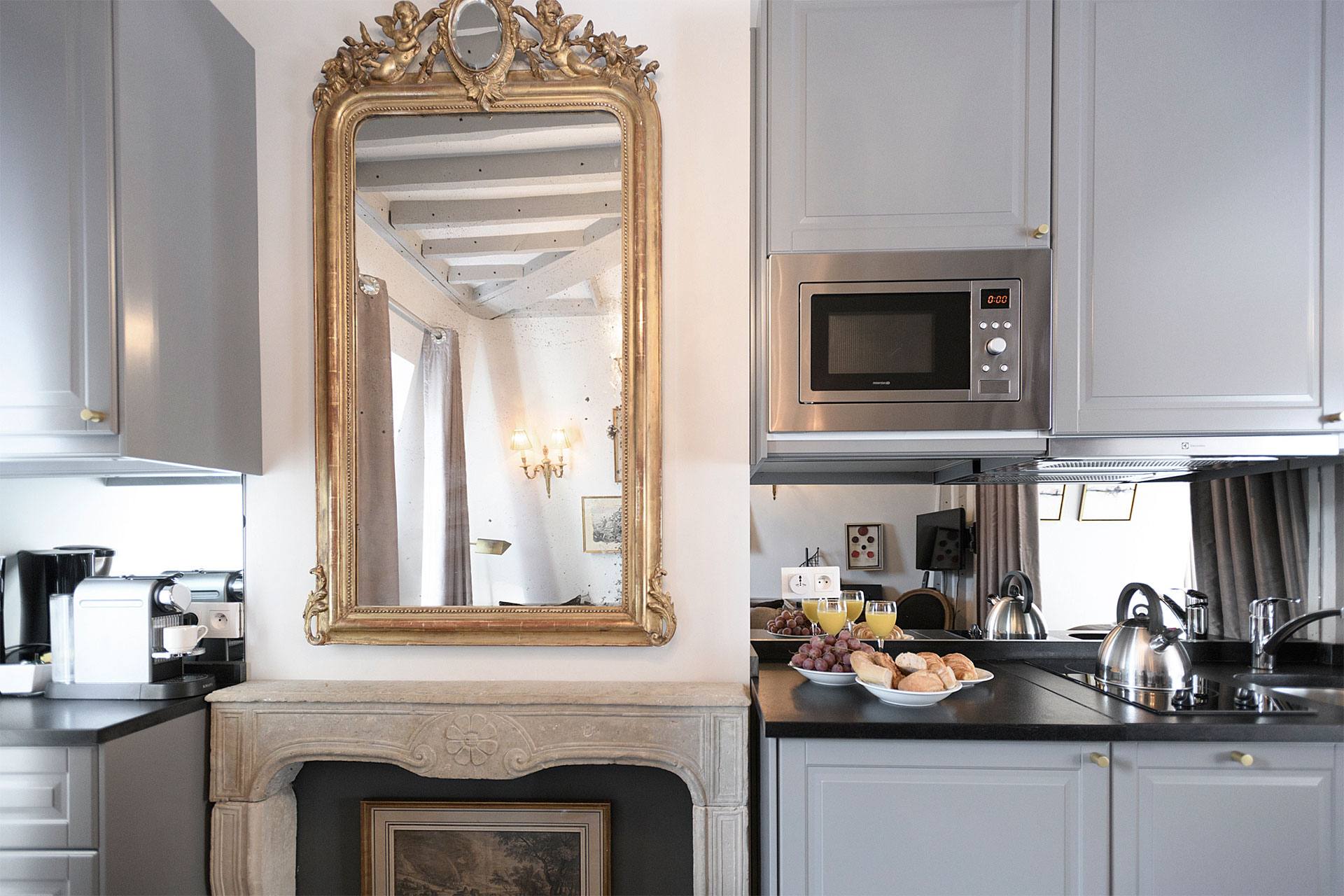Stunning fireplace is a feature in the open kitchen at the Cremant Paris Perfect rental