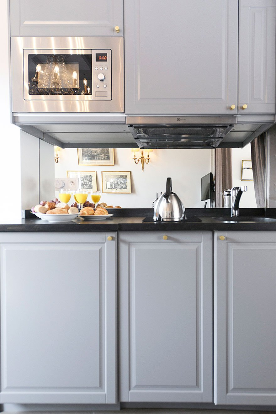 Soft grey tones in the Cremant kitchen offered by Paris Perfect
