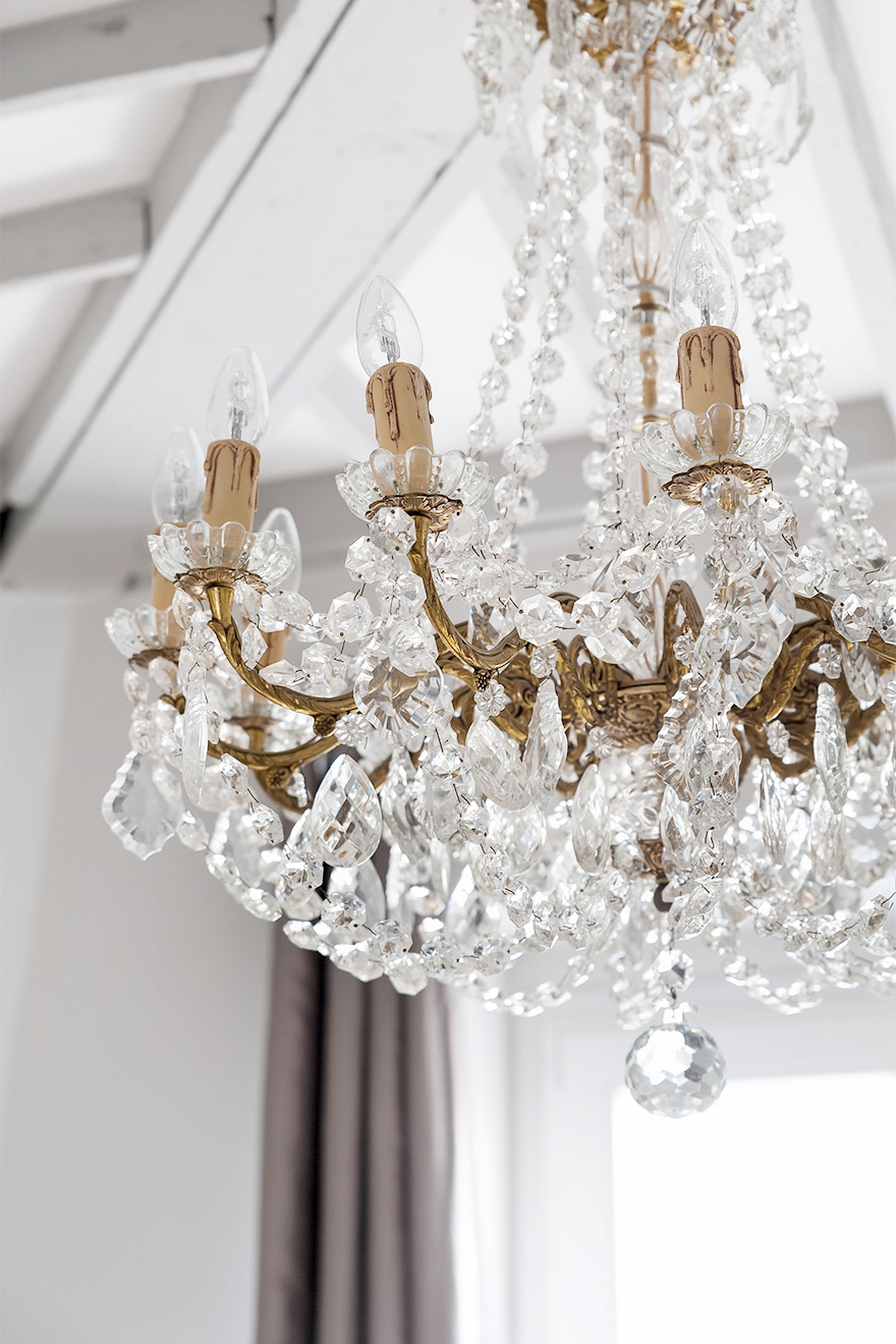 Beautiful chandeliers in the kitchen and above the bed in the Cremant vacation rental by Paris Perfect