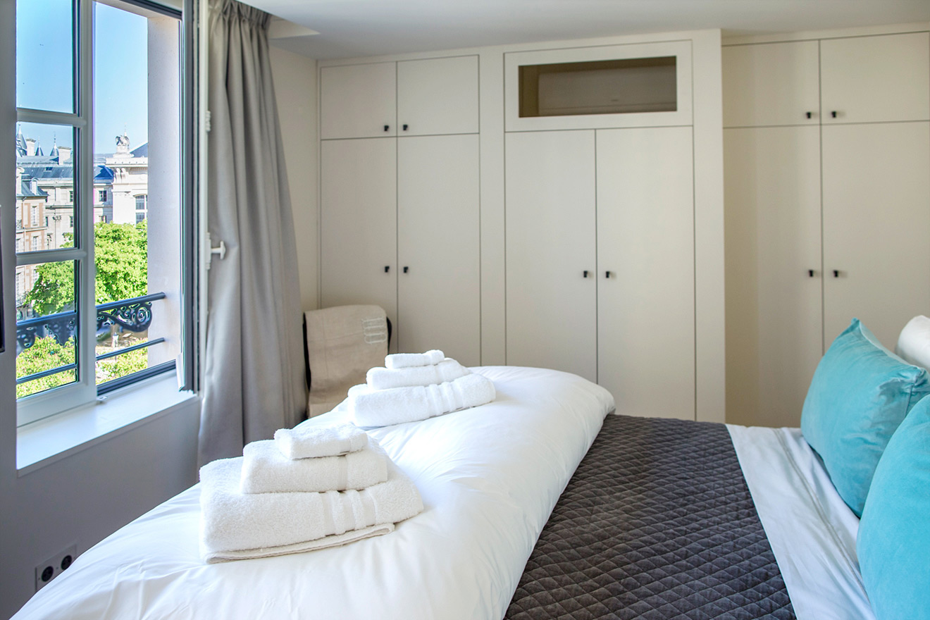 Bedroom overlooks Place Dauphine in the Savennières vacation rental offered by Paris Perfect