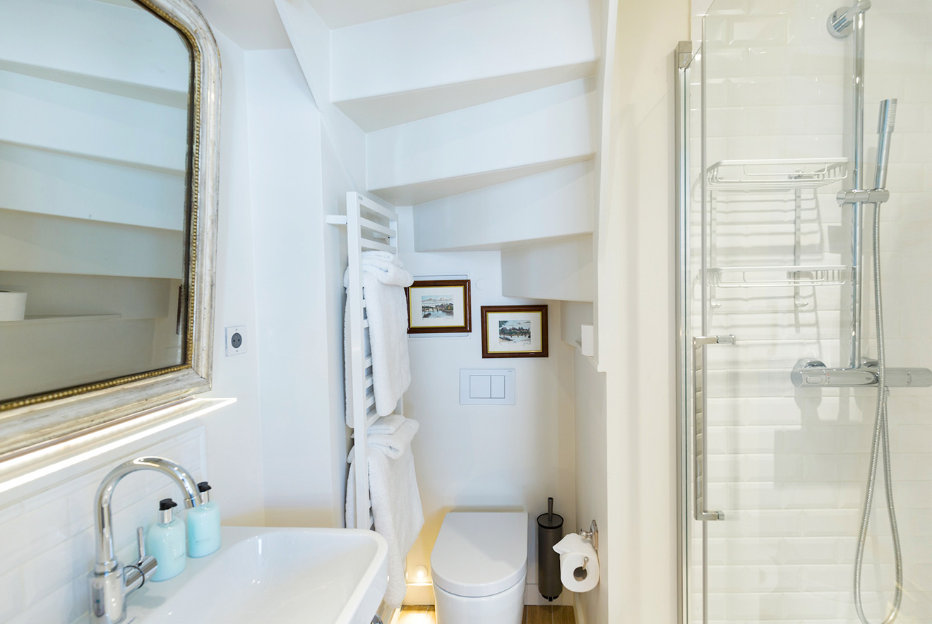 Modern bathroom with shower, toilet and basin in the Savennières vacation rental offered by Paris Perfect