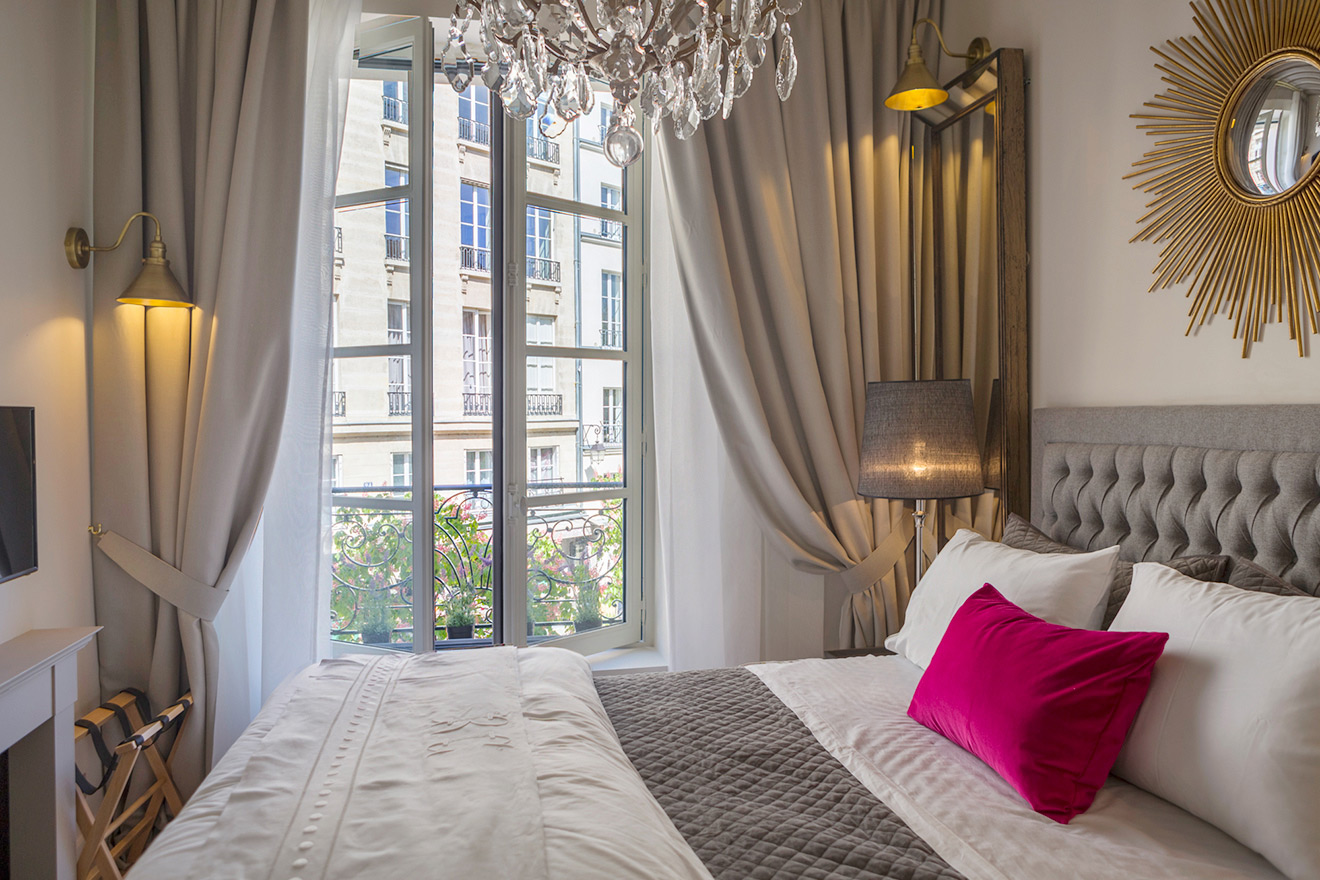 View of the stunning Place Dauphine from the bedroom of the Muscat vacation rental offered by Paris Perfect