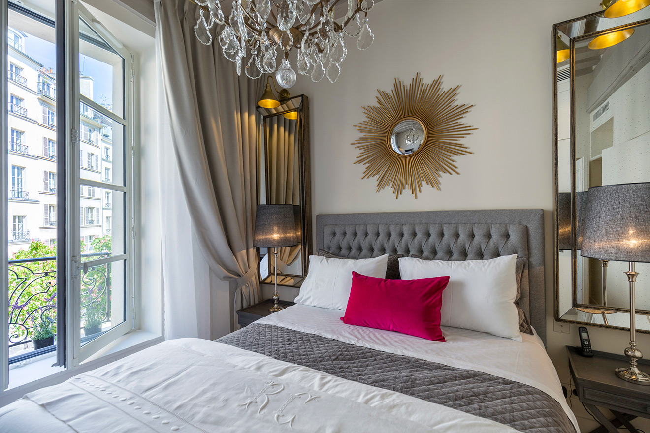 Beautiful bedroom with sumptuous dual-queen size bed in the Muscat vacation rental offered by Paris Perfect