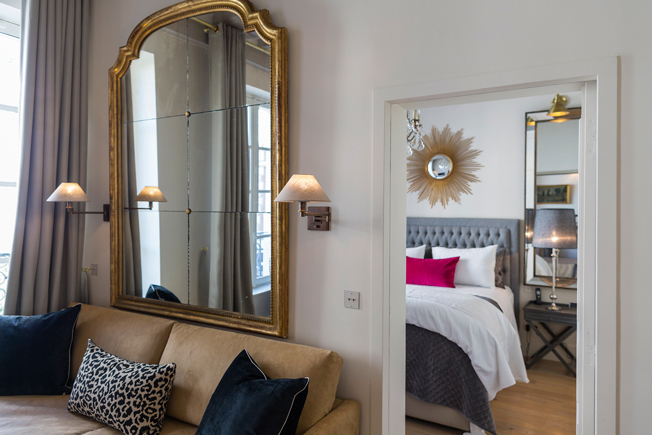 Doorway to bedroom is just off the living room of the Muscat vacation rental offered by Paris Perfect