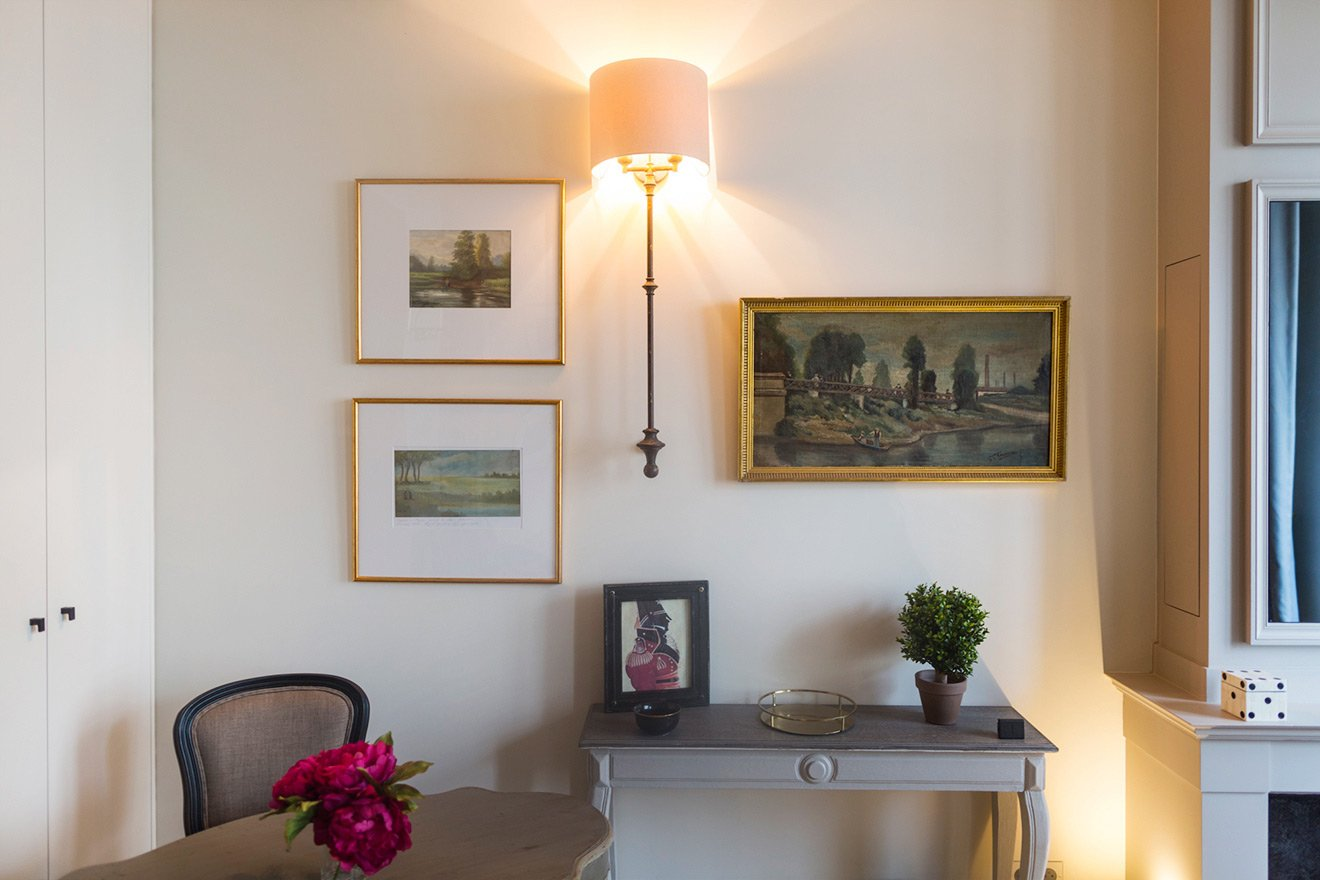 Striking wall sconces in the living room of the Muscat vacation rental offered by Paris Perfect