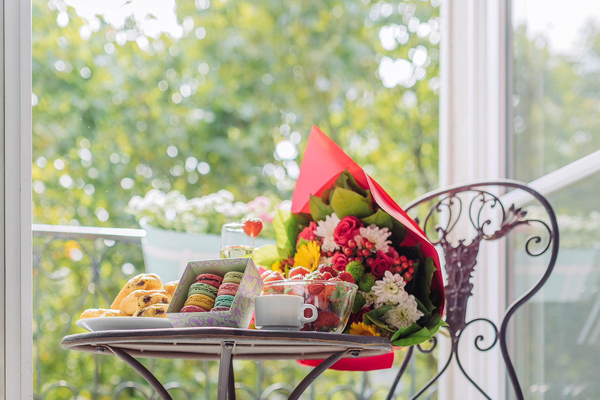 Set a romantic table on the balcony of the Chambertin vacation rental offered by Paris Perfect
