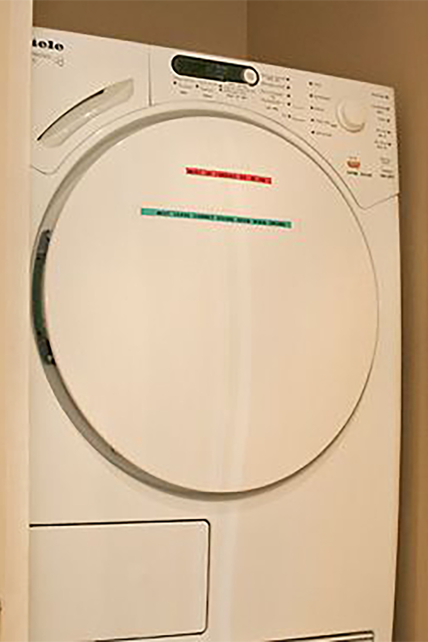 Top-of-the-line Miele clothes dryer in the Saint Amour vacation rental offered by Paris Perfect