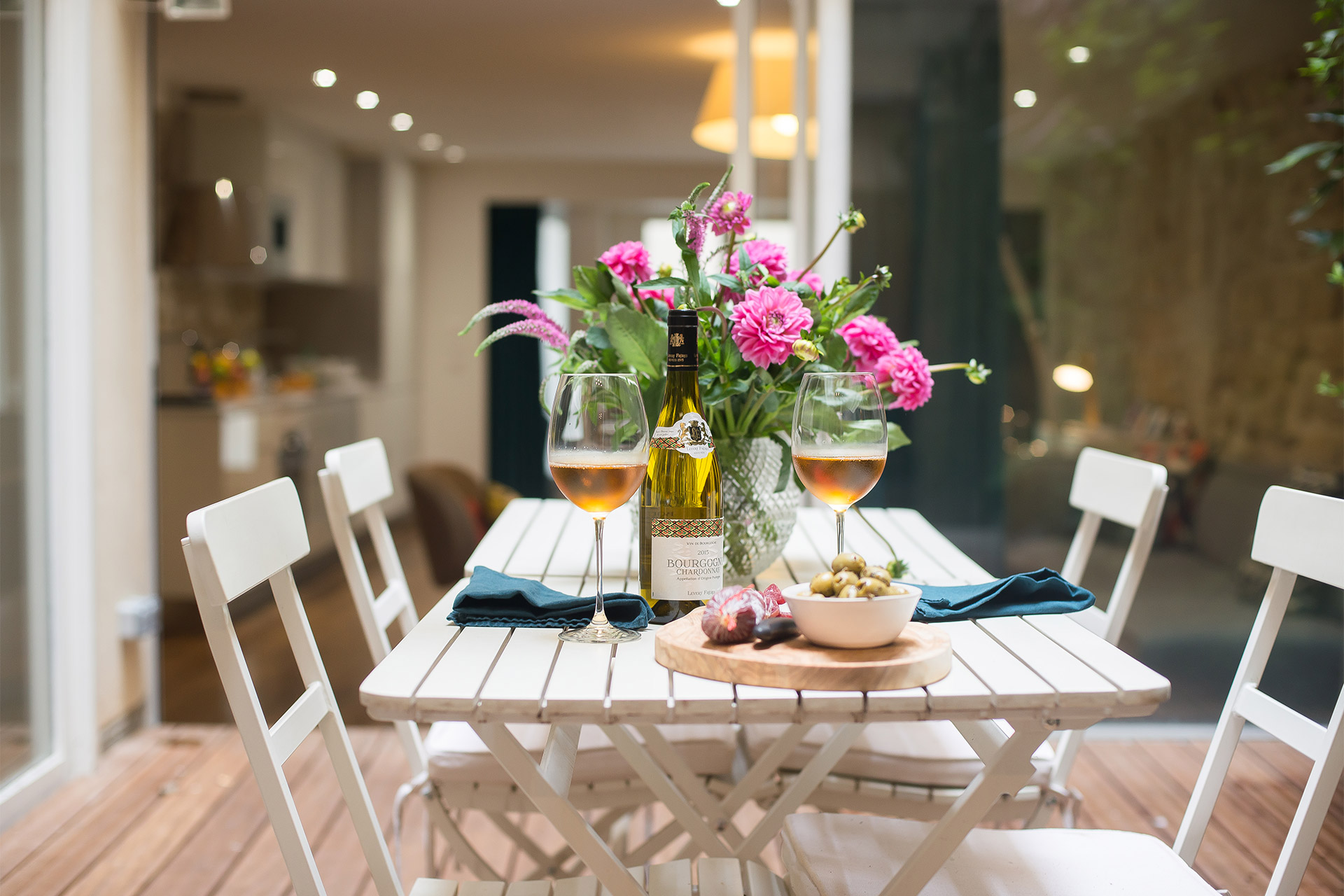 Enjoy meals al-fresco in your private garden at the Lascombes Paris Perfect rental