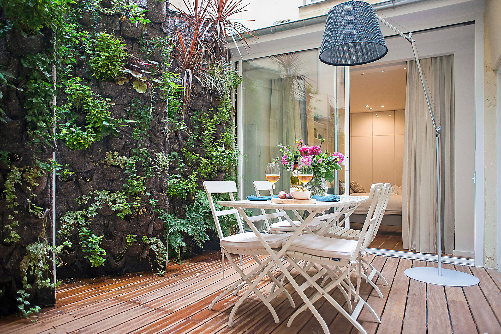 Stunning garden wall in the private oasis Lascomes in the heart of the Marais