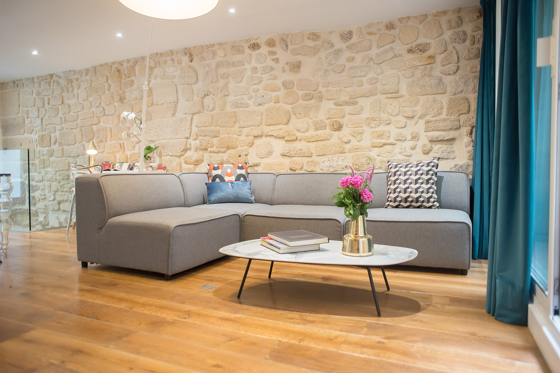 Large modern sofa and armchairs for casual entertaining in the Lascombes Paris Perfect rental