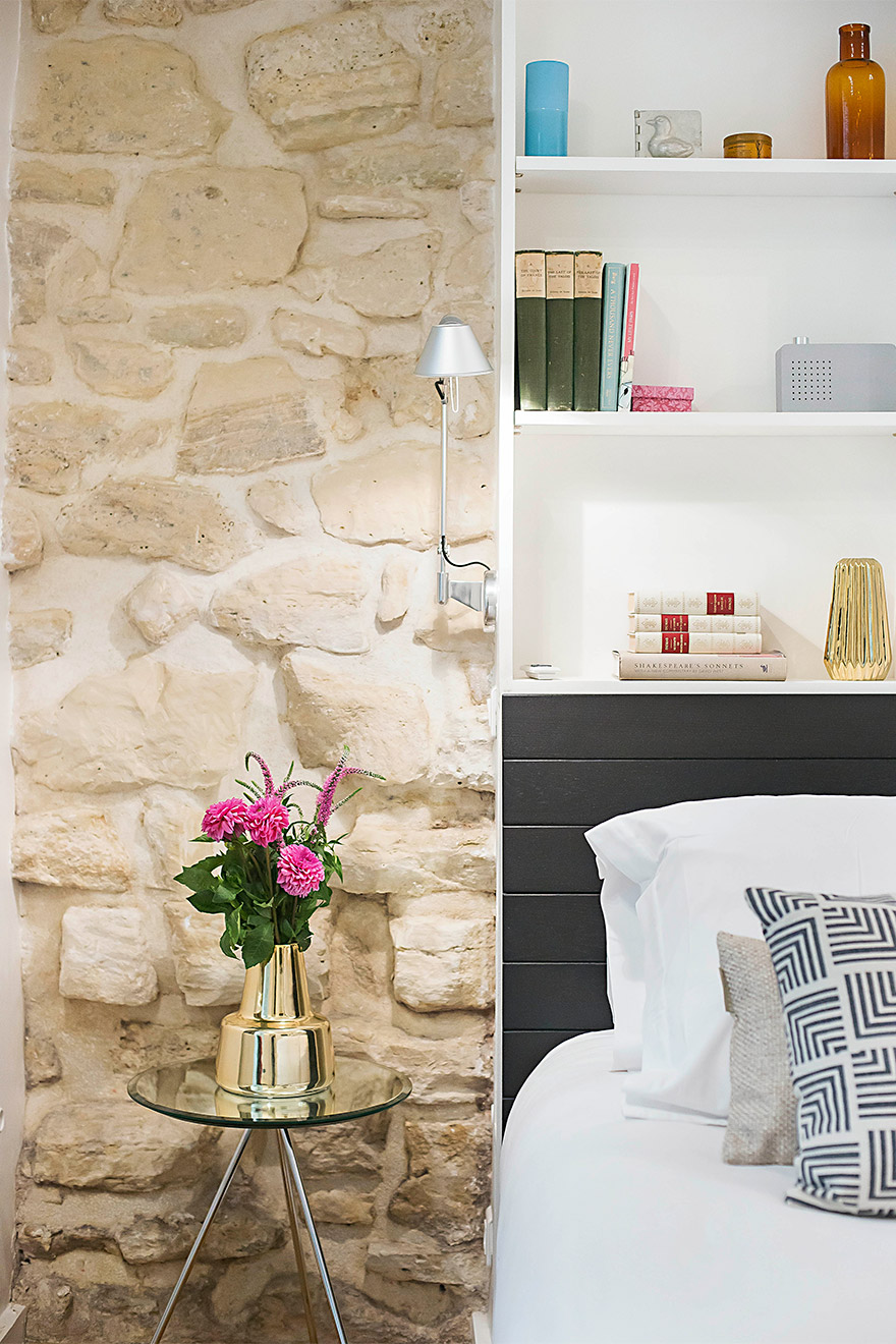 Authentic stone walls are a feature in the first bedroom in the Lascombes rental