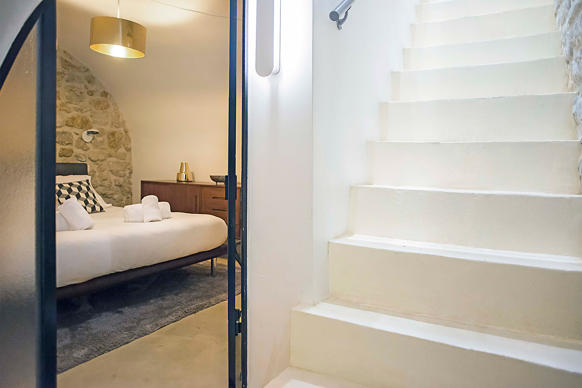 Staircase leading downstairs to the third bedroom and bathroom in the Lascombes rental