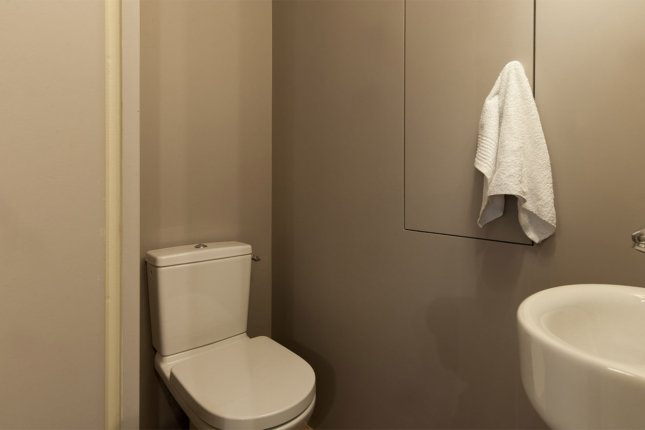 Separate half bath with toilet and sink