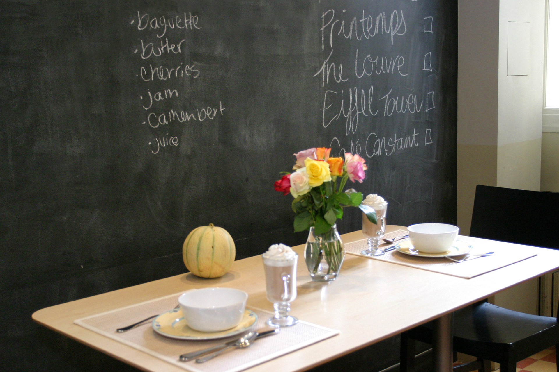 Kitchen blackboard behind the table in the Mâcon vacation rental offered by Paris Perfect