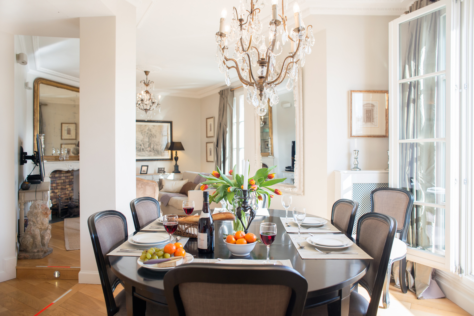 Open plan living and dining area of the Margaux vacation rental offered by Paris Perfect