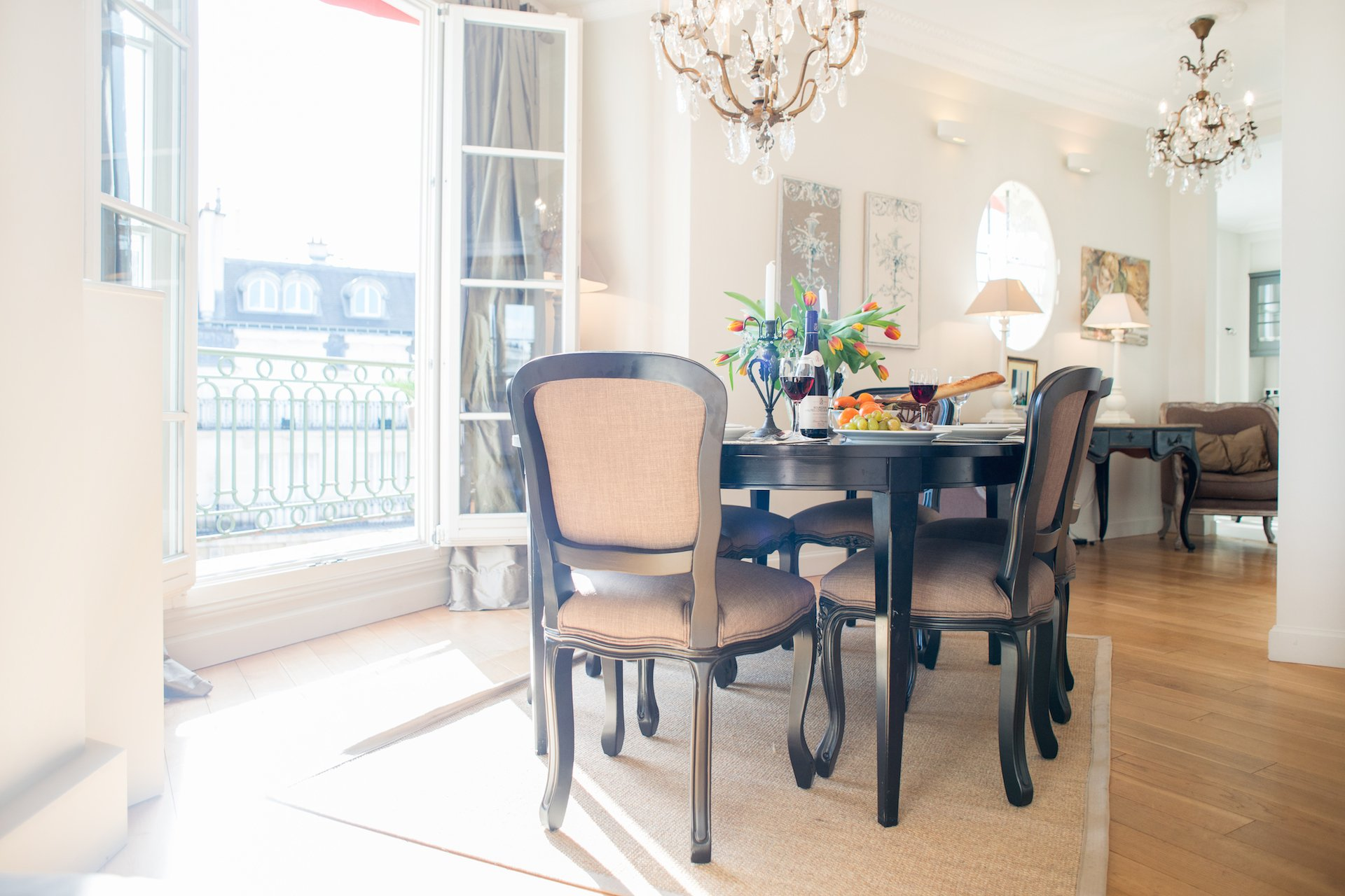 Paris rooftops from the dining table in the Margaux vacation rental offered by Paris Perfect