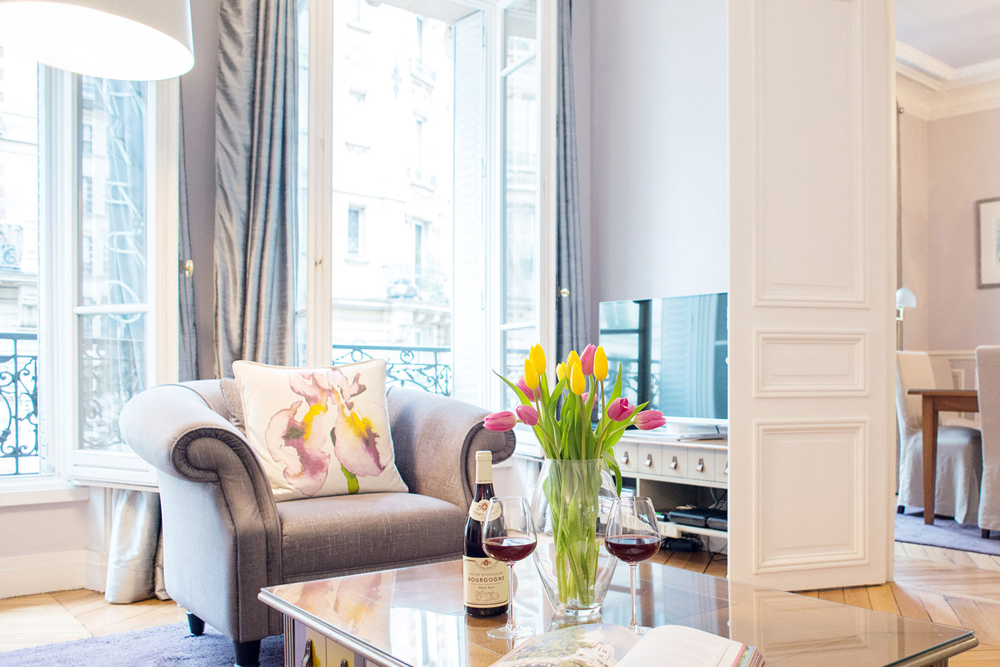 Large French windows in the living room of the Maubert vacation rental offered by Paris Perfect