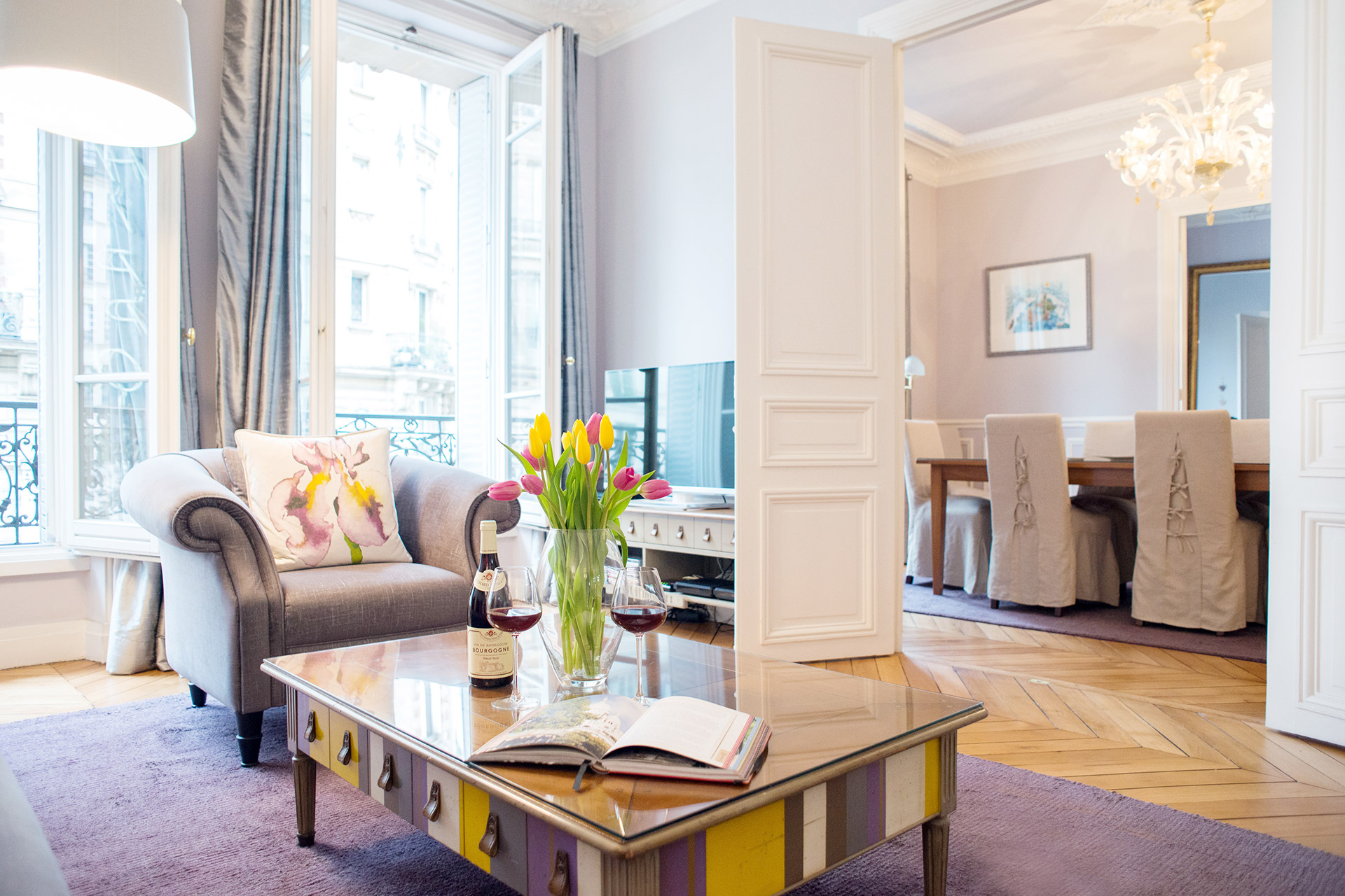 Living room has a large flat-screen TV in the Maubert vacation rental offered by Paris Perfect