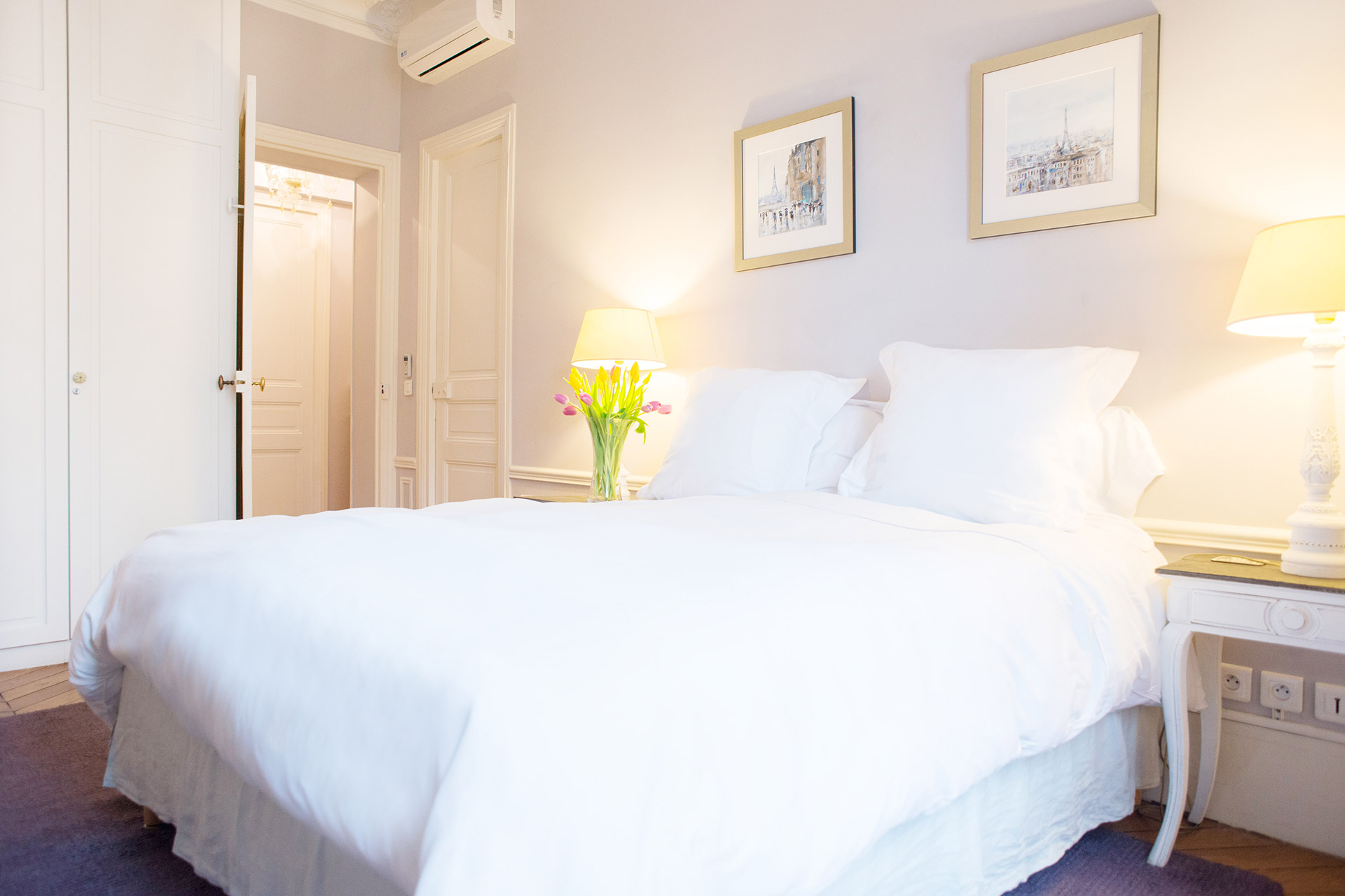 Magnificent mauve touches in the master bedroom of the Maubert vacation rental offered by Paris Perfect