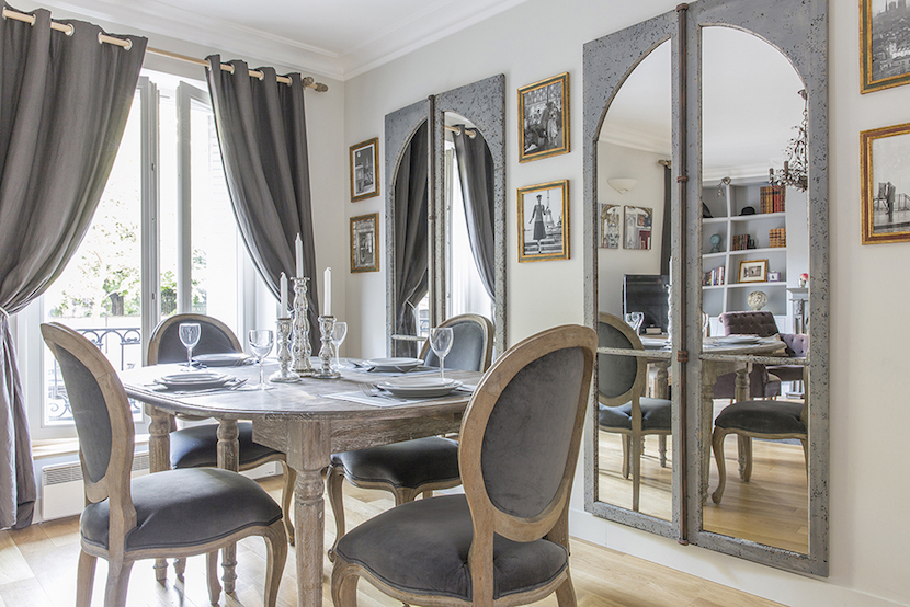 Dining table seats six in the Beaujolais vacation rental offered by Paris Perfect