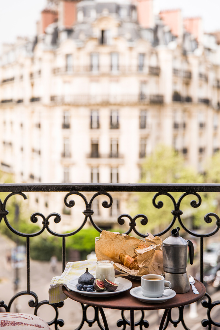 Breakfast al fresco on the balcony of the Champagne vacation rental offered by Paris Perfect