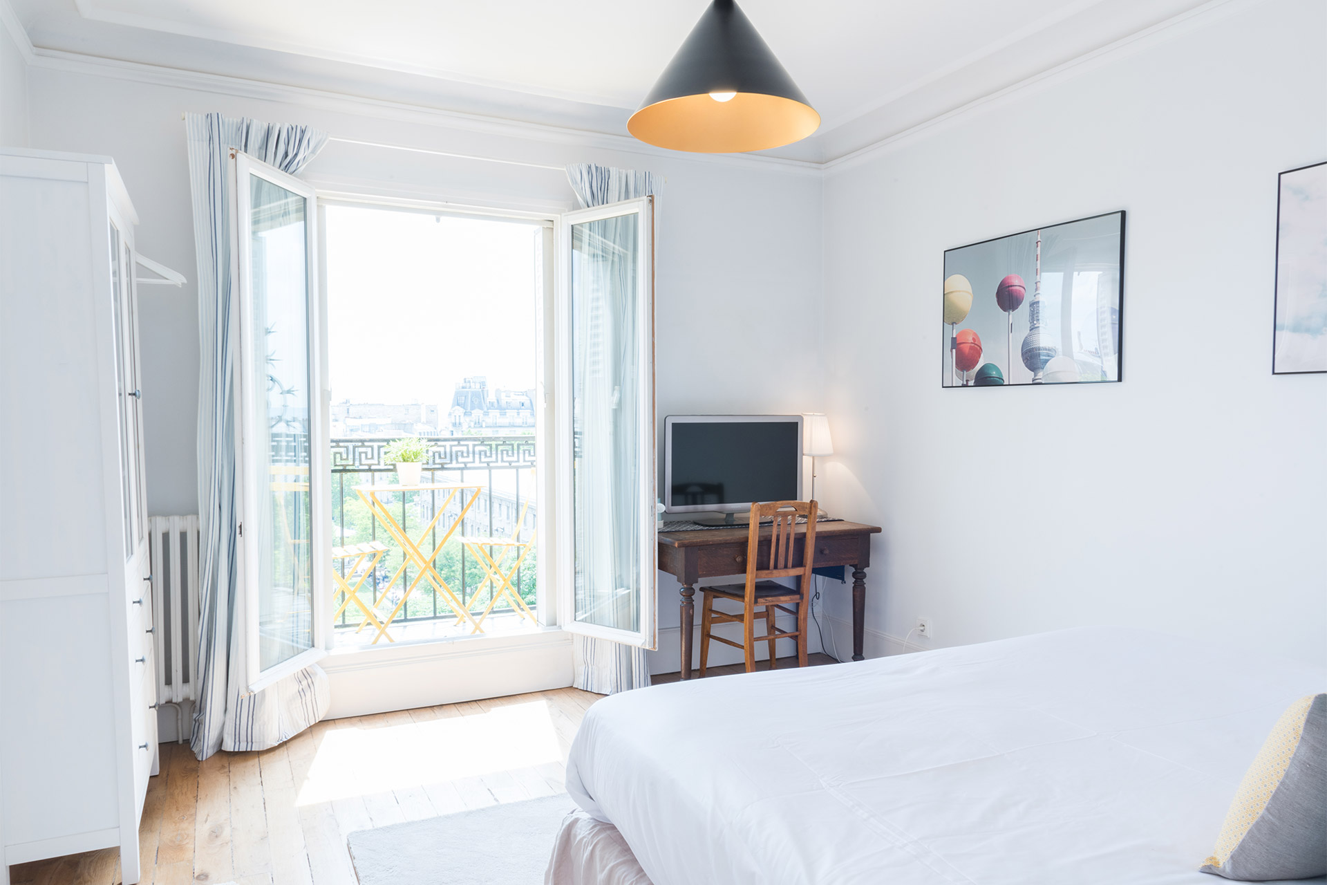 Large window in the first bedroom of the Mondeuse vacation rental offered by Paris Perfect