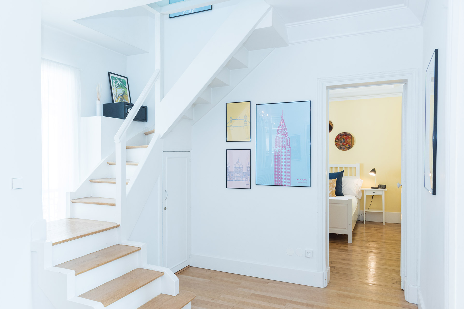 View of the staircase with the second bedroom in the Mondeuse vacation rental offered by Paris Perfect