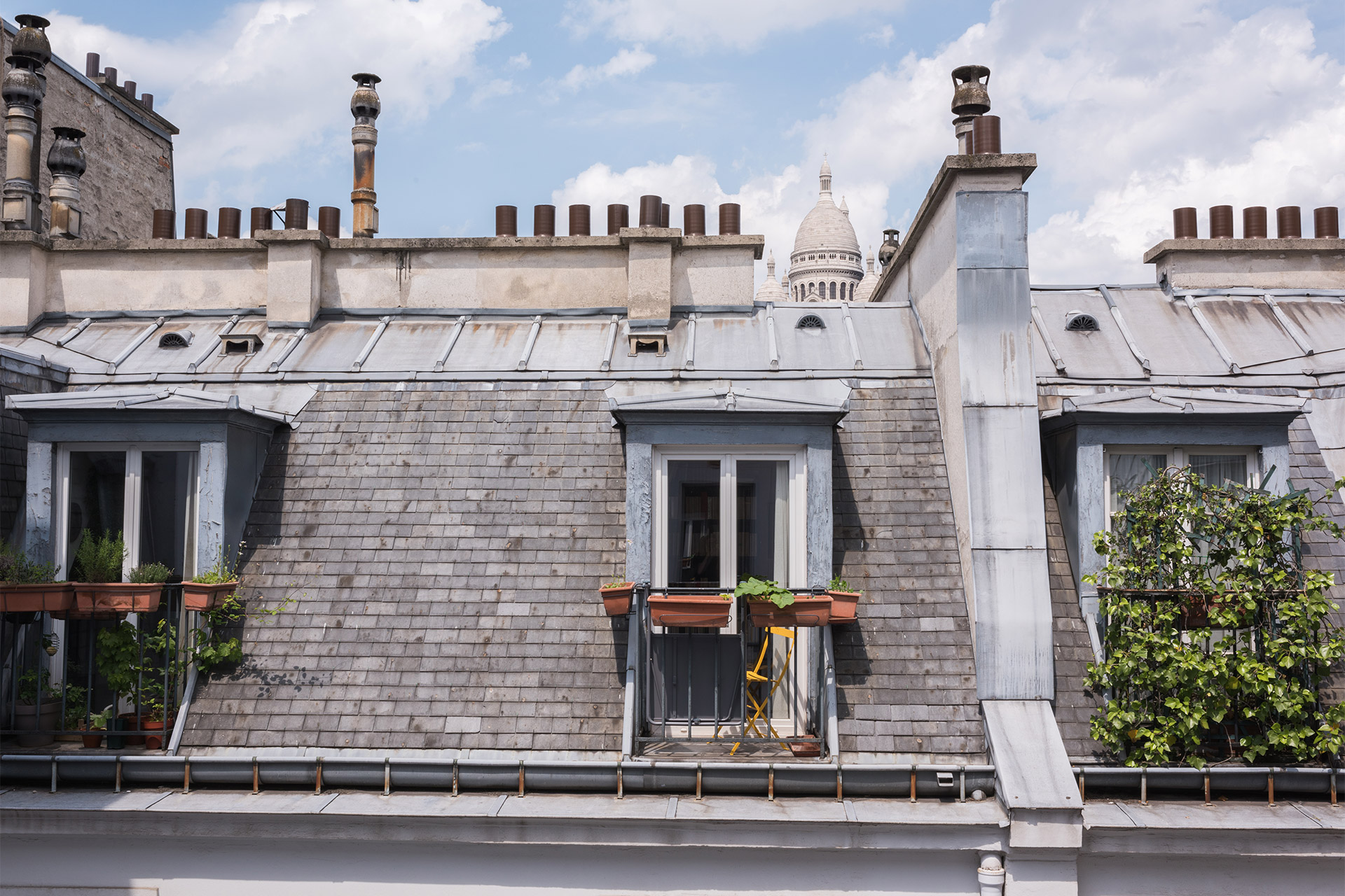 Spot the Sacré Coeur peaking over the Paris rooftops from the upstairs bathroom