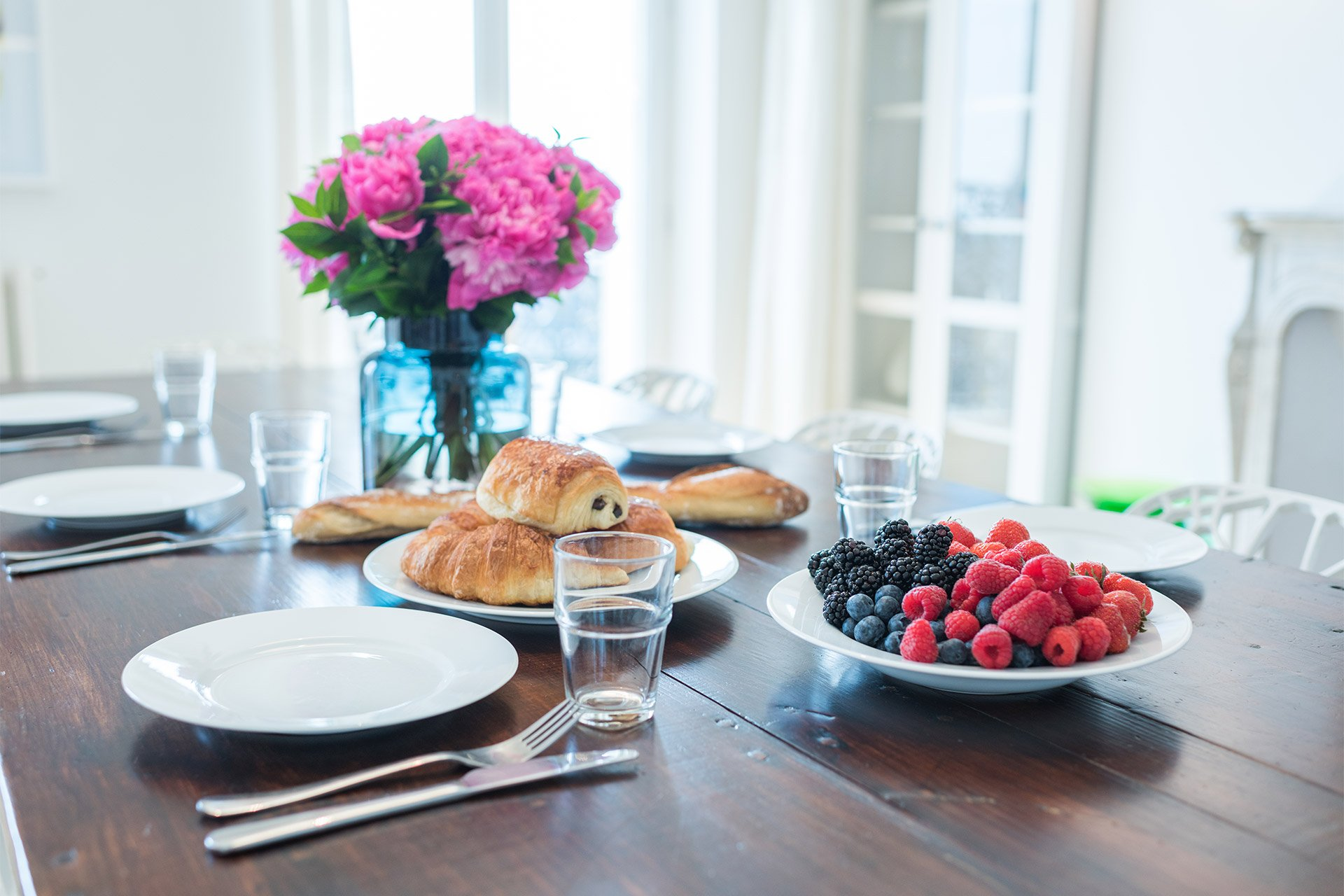 Fresh croissants and fruit in the Mondeuse vacation rental offered by Paris Perfect