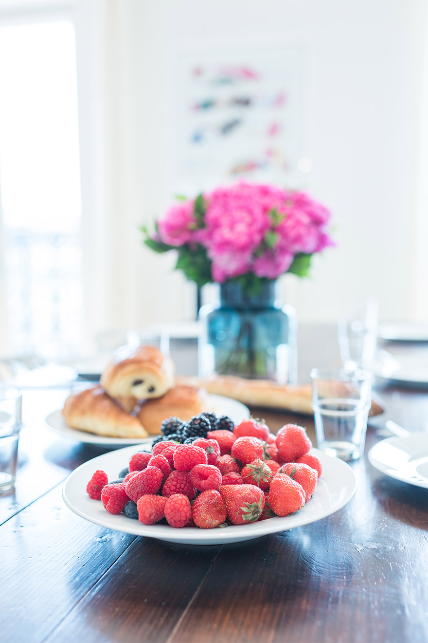 Fresh croissants, fruit and flowers in the Mondeuse vacation rental offered by Paris Perfect