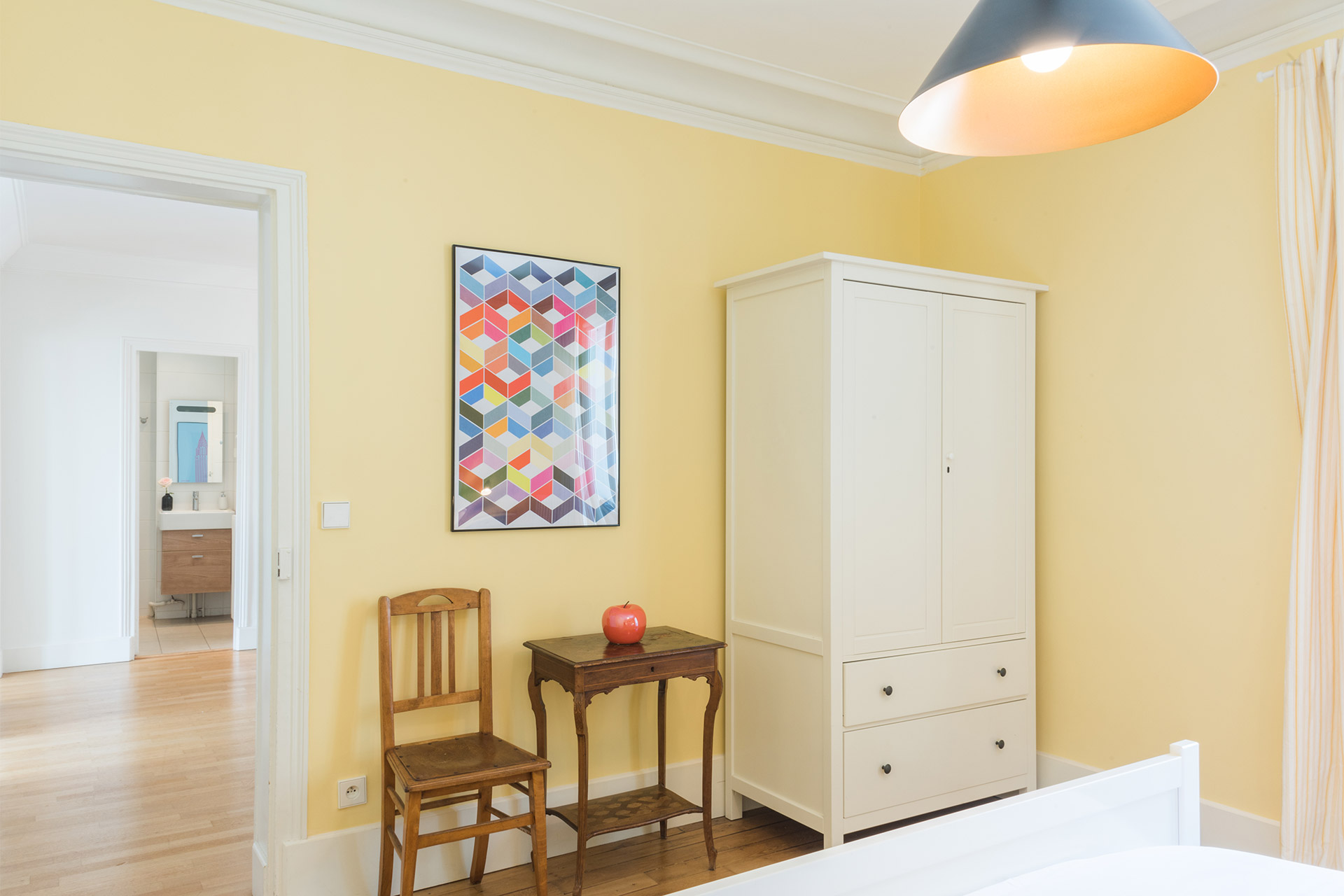 A closet and small desk in the Mondeuse vacation rental offered by Paris Perfect