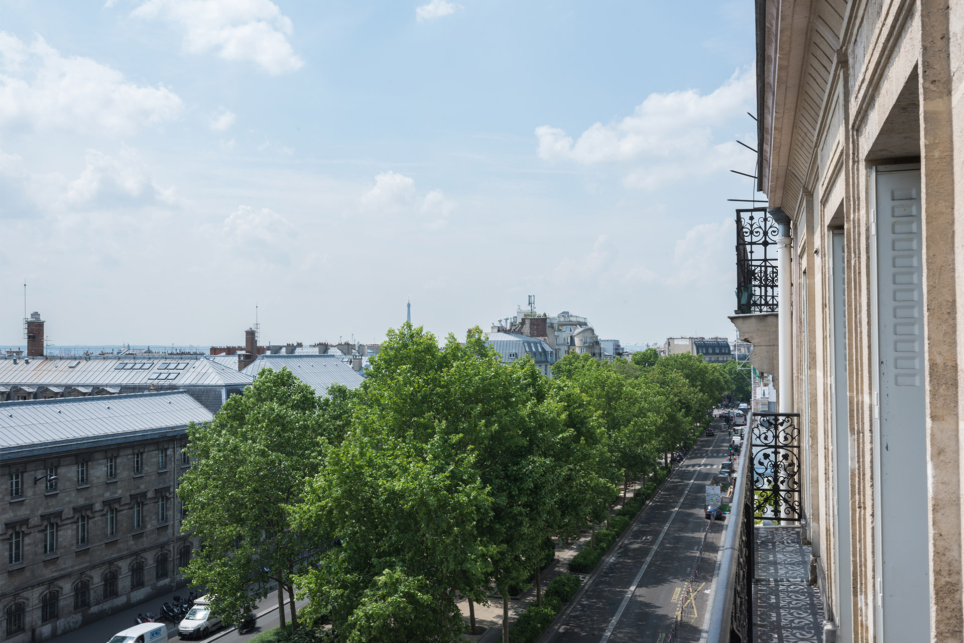 Long step-out balcony offering wide Parisian views in the Mondeuse vacation rental offered by Paris Perfect