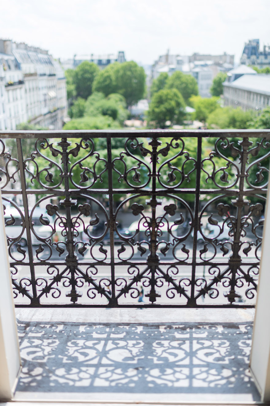 Ornate wrought iron details on the balcony of the Mondeuse vacation rental offered by Paris Perfect