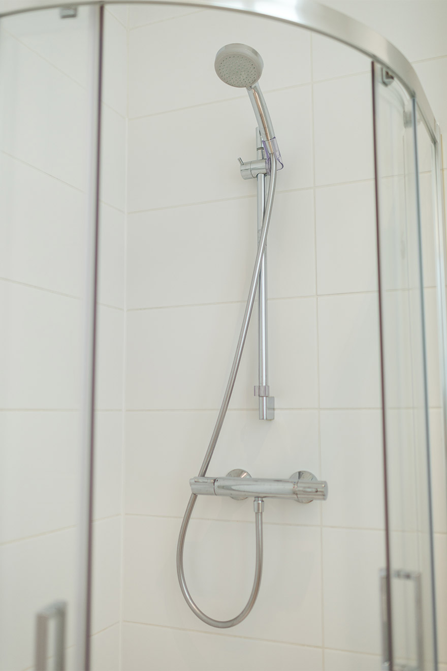 Flexible shower head in the bathroom of the Mondeuse vacation rental offered by Paris Perfect