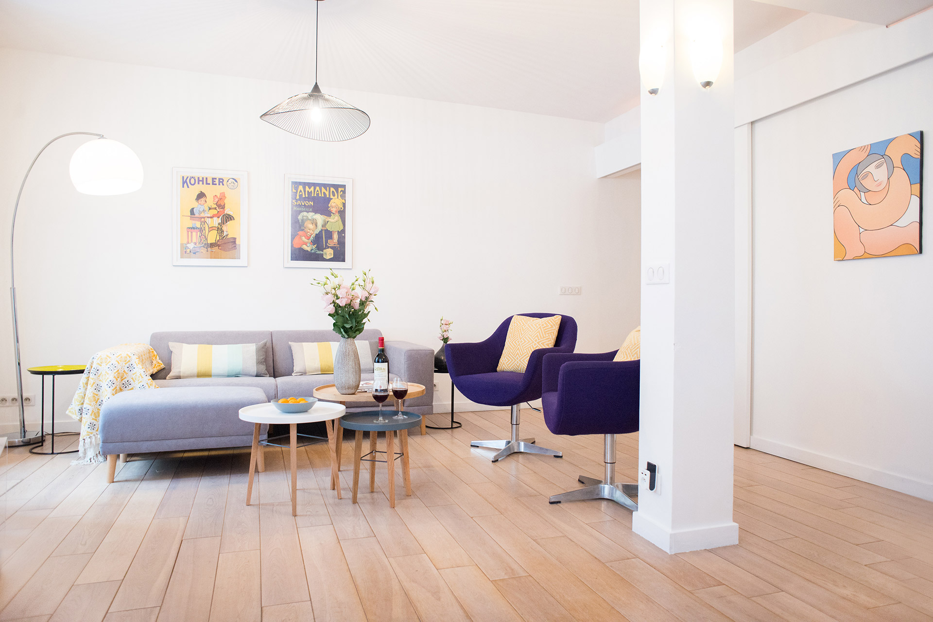 Colorful, modern design compliment the living space of the Monplaisir vacation rental offered by Paris Perfect