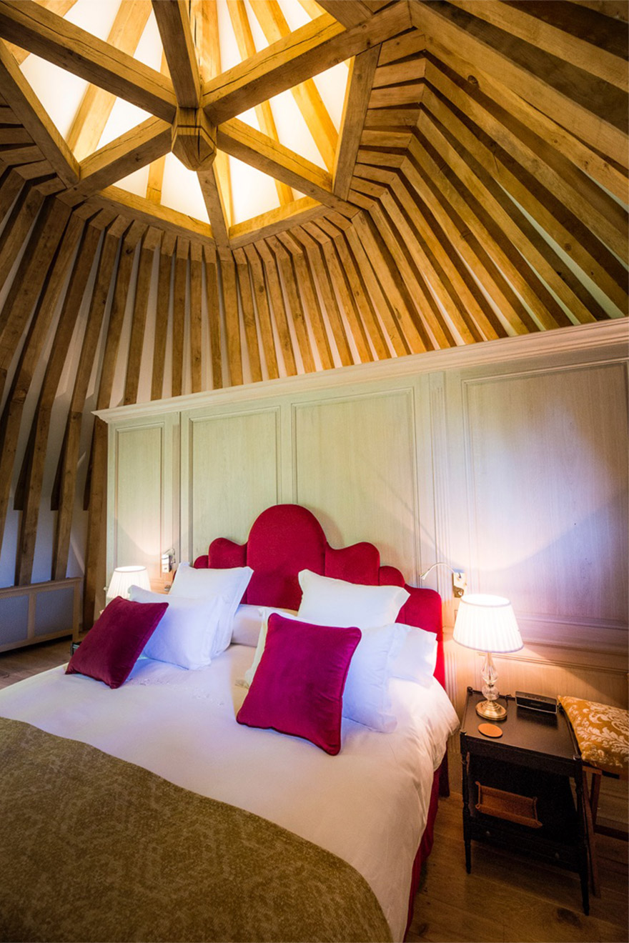 Beautiful wooden beams on the walls and ceiling in the Normandy Livarot Suite