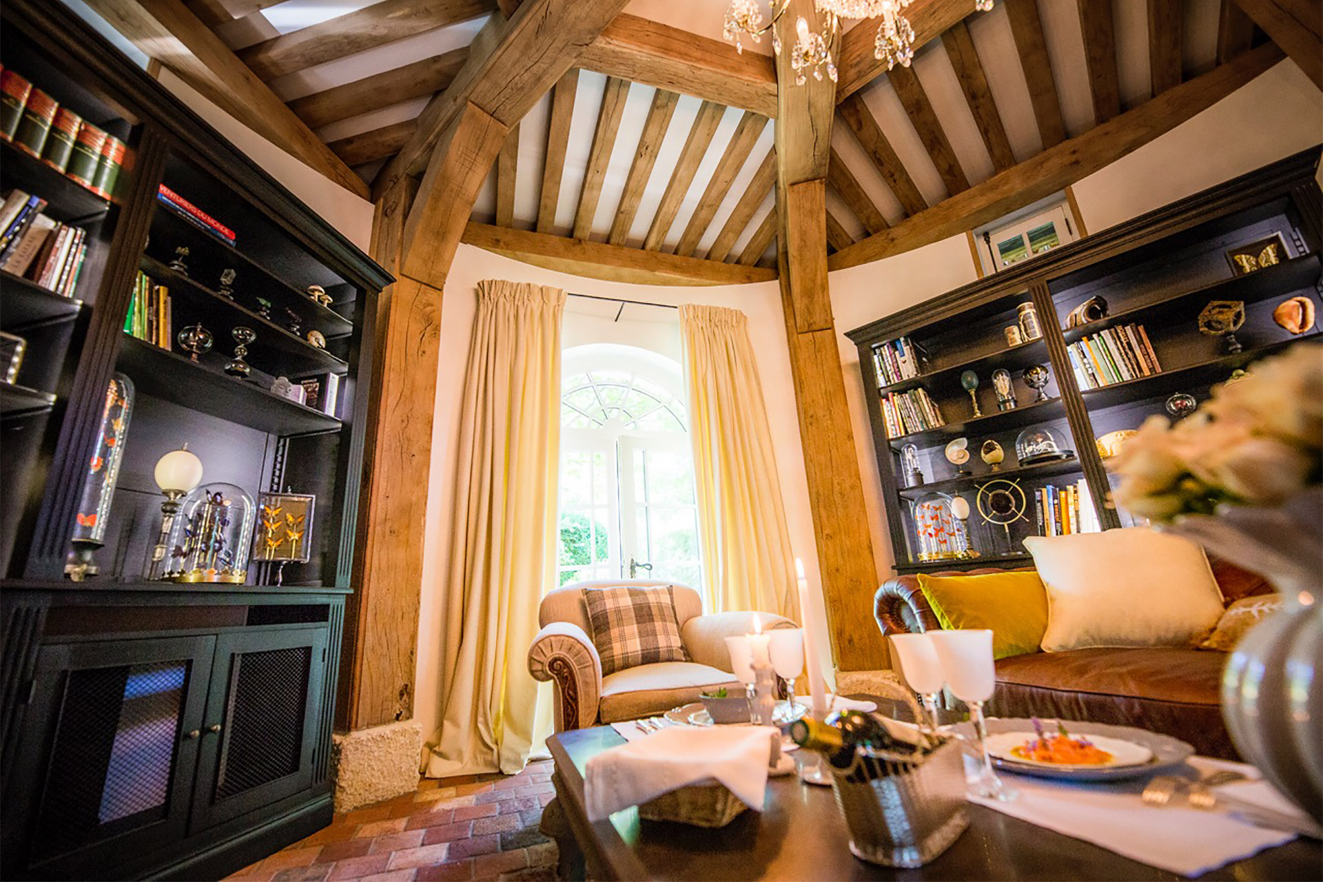 Large window in the living room lets in lots of light in this Normandy rental