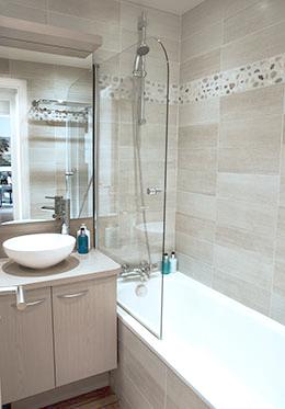Bathroom beige wood look tiles modern sink